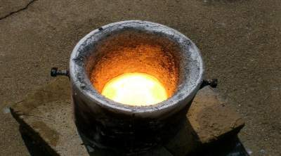 Molten charge after aluminothermic reduction process